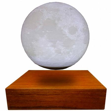 Globe lumineux sur base bois en lévitation